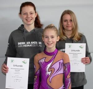 Julia Fenn (links), Emily Murmann (rechts) und Julia Tolksdorf (mitte) haben sich kürzlich für die Hessischen Einzelmeisterschaften Gymnastik qualifiziert